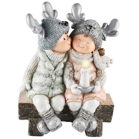 Decoratie kerst winterkindjes meisje jongen op bank 23x18x12 cm| A215027 | Dekoratief